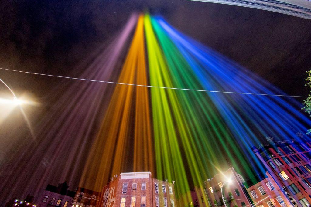 <p>A view of Pride coloured lights are projected into the sky on June 27, 2020 in New York City.</p>