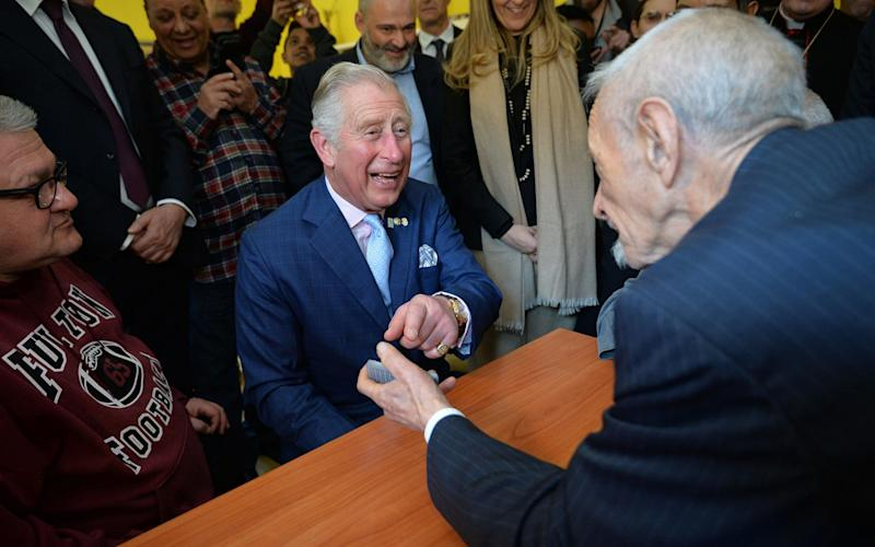 The Prince of Wales enjoys a quick hand of cards at theCasa San Paolino shelter - PA