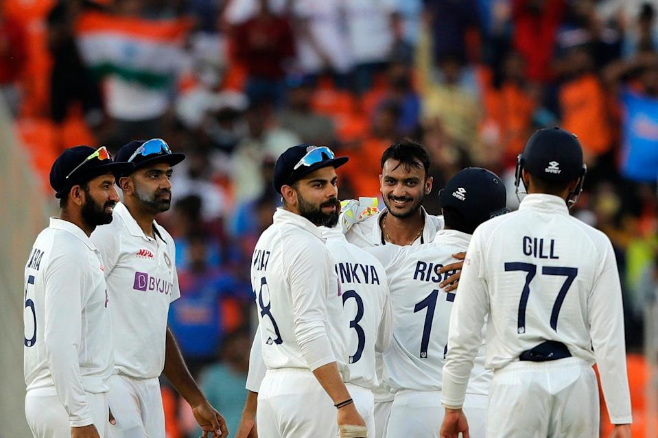 India celebrate after Axar takes a wicket on day oneBCCI