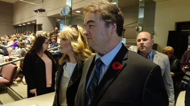 Coun. Rick Chiarelli enters the council chamber on November 2019.  A new petition launched by women who came forward about the councillor's inappropriately behaviour is seeking changes to the Ontario's Municipal Act.  (Giacomo Panico/CBC - image credit)