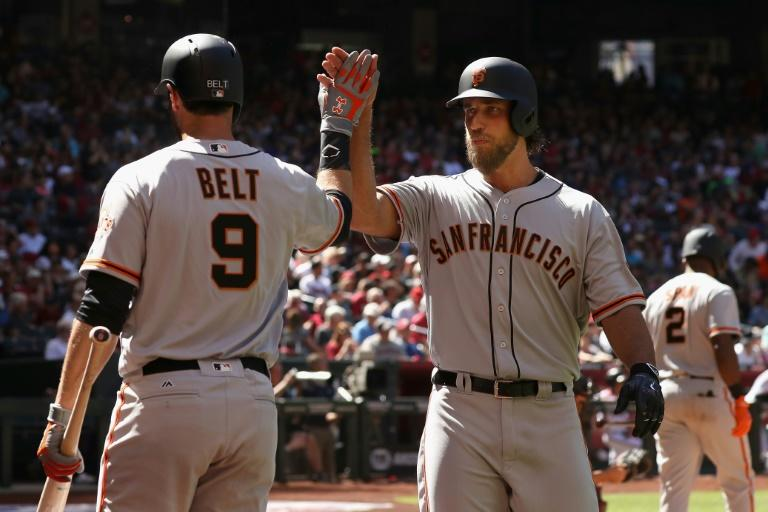 San Francisco Giants pitcher Madison Bumgarner celebrates the first of two home runs against the Arizona Diamondbacks