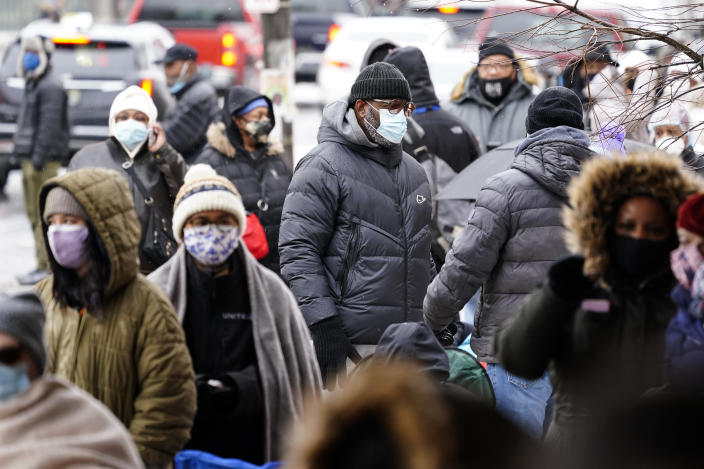 People wait in line for the opening of a 24-hour, walk-up COVID-19 vaccination clinic hosted by the Black Doctors COVID-19 Consortium at Temple University's Liacouras Center in Philadelphia, Friday, Feb. 19, 2021. (AP Photo/Matt Rourke)