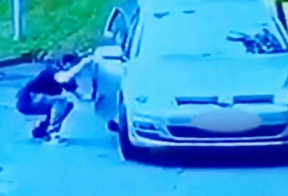 William Lewis steals a car while its owner vacuums the back seat on a station forecourt. (SWNS)