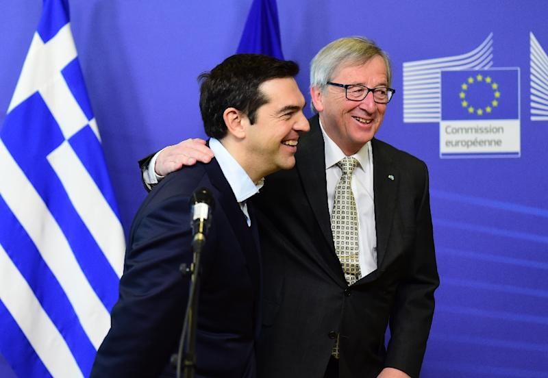 Greece's Prime Minister Alexis Tsipras (L) is welcome by European Commission President Jean-Claude Juncker at the European Commission in Brussels on March 13, 2015 (AFP Photo/Emmanuel Dunand)