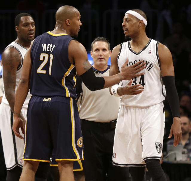 Indiana Pacers' David West, left, talks with Brooklyn Nets' Paul Pierce after Pierce was called for a flagrant foul during the second half of an NBA basketball game Monday, Dec. 23, 2013, in New York. The Pacers defeated the Nets 103-86. (AP Photo/Seth Wenig)