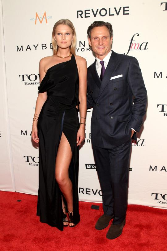 <p>Sartorially speaking, the hosts of the award show brought it in a big way. Victoria's Secret model Garrn looked the part of a sexy Greek goddess in a black, draped gown slit up to there. She accessorized with sleek hair and several simple gold cuffs and a choker necklace. Scandal star Goldwyn thought outside the typical menswear box in a navy checked suit by Brooks Brothers, paired with a purple tie, white pocket square, and brown suede shoes. All hail the Tony/Toni Gs!</p>