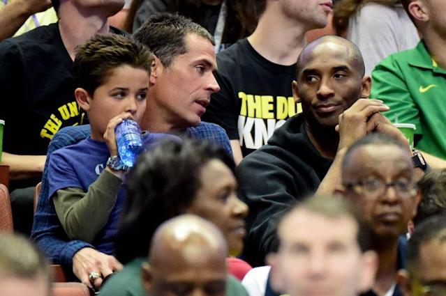 Rob Pelinka talks with Kobe Bryant at the NCAA men's regional in Anaheim, Calif., last year. (Getty Images)