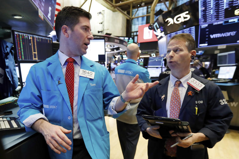 Specialist Thomas McArdle, left, and trader Robert Charmak work on the floor of the New York Stock Exchange, Wednesday, Jan. 9, 2019. Stocks are opening higher on Wall Street, putting the market on track for a fourth gain in a row. (AP Photo/Richard Drew)