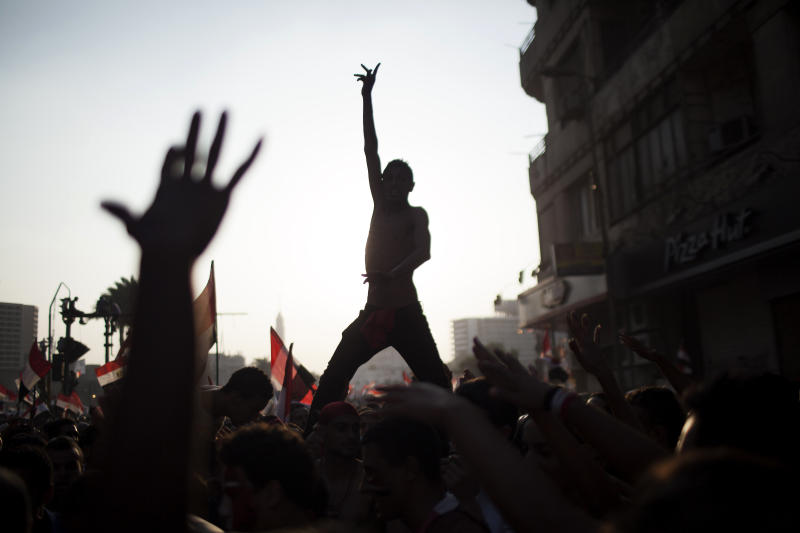"FILE - In this Wednesday, July 3, 2013 file photo, Egyptian protesters chant slogans against Egyptian Islamist President Mohammed Morsi, who was ousted later that day, in Tahrir Square in Cairo. Almost a quarter-century ago, a young American political scientist achieved global academic celebrity by proclaiming that the collapse of communism had ended the discussion on how to run societies, leaving ""Western liberal democracy as the final form of human government."" In Egypt and around the Middle East, after a summer of violence and upheaval, the discussion, however, is still going strong. And almost three years into the Arab Spring revolts, profound uncertainties remain. (AP Photo/ Manu Brabo, File)"