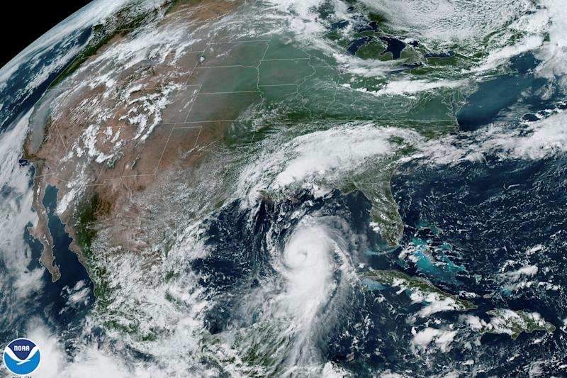 Hurricane Laura approaches the coasts of Texas and Louisiana in an image from the National Oceanic and Atmospheric Administration (NOAA) GOES-East satellite.