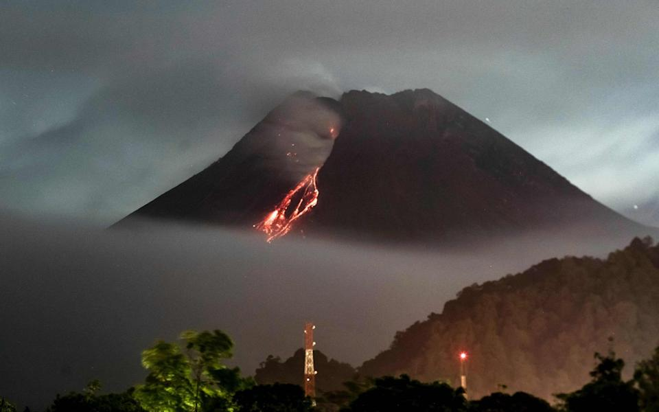 Lava flows down from the crater of Mount Merapi, Indonesia's most active volcano - AFP