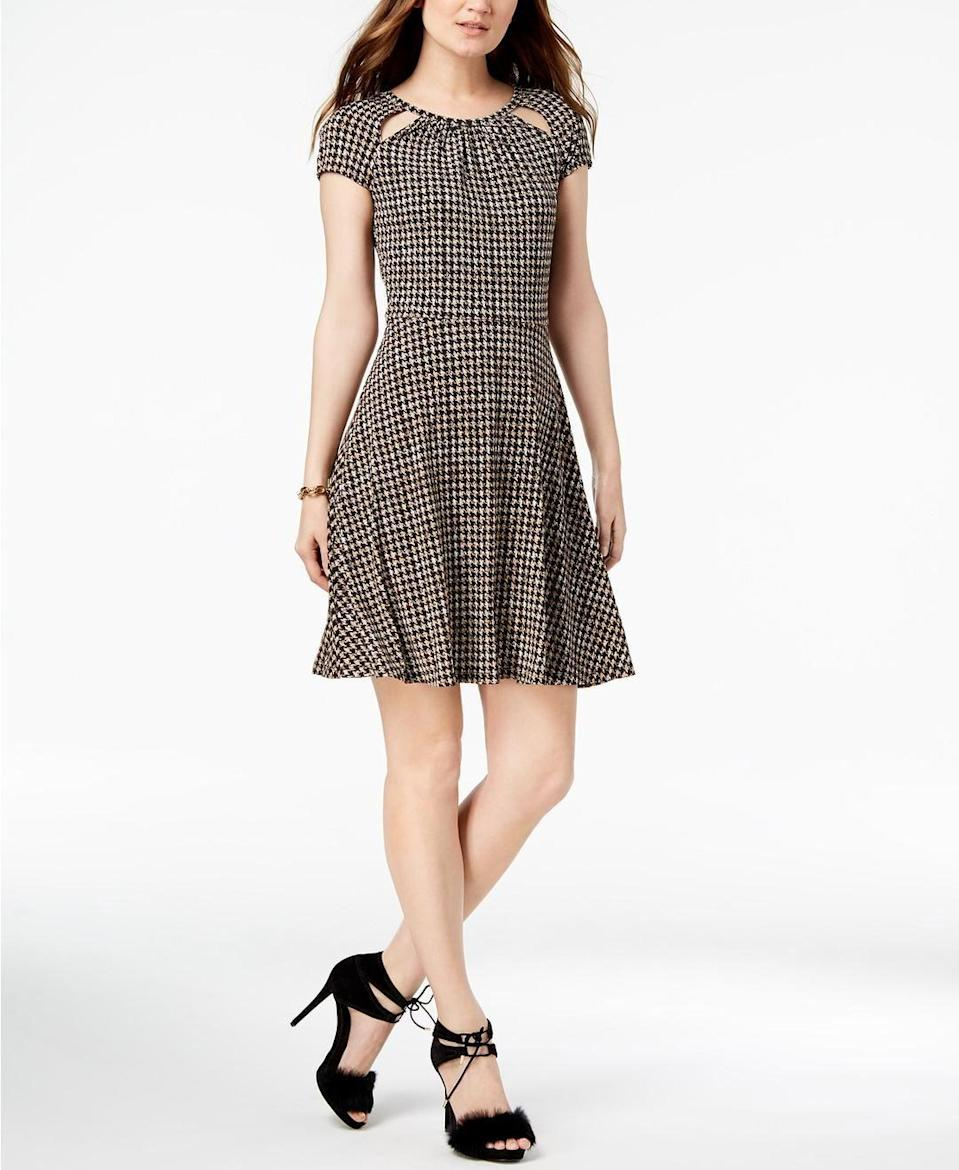 The plaid pattern on this dress screams fall.