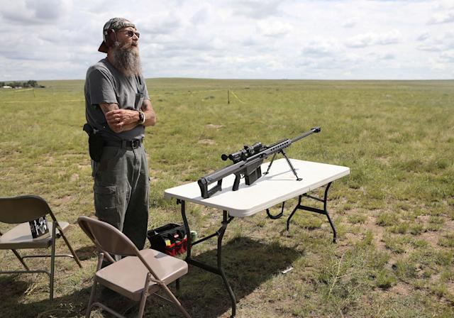 <p>A member of self-described patriot groups and militias prepares to shoot a .50 caliber rifle during III% United Patriots' Field Training Exercise outside Fountain, Colo., July 29, 2017. (Photo: Jim Urquhart/Reuters) </p>