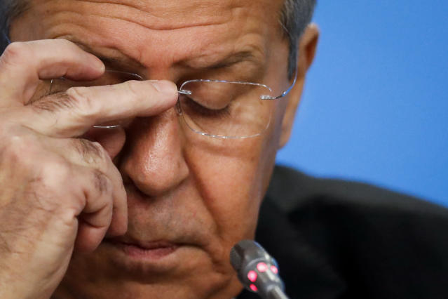 Russian Foreign Minister Sergey Lavrov adjusts his glasses while speaking about his department's 2018 accomplishments during his annual roundup news conference in Moscow, Russia, Wednesday, Jan. 16, 2019. Russia's foreign minister has ridiculed allegations that U.S. President Donald Trump could have worked for Moscow's interests. (AP Photo/Pavel Golovkin)
