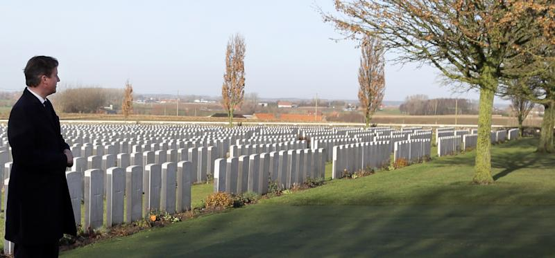 British Prime Minister David Cameron looks out over rows of World War One graves as he visits Tyne Cot Cemetery in Zonnebeke, Belgium on Thursday, Dec. 19, 2013. Both heads of state are visiting several World War One sites ahead of a four year Centenary program which begins in 2014. Tyne Cot is the largest Commonwealth war cemetery in the world in terms of burials. (AP Photo/Virginia Mayo)