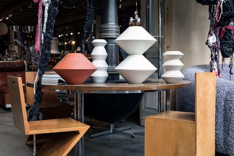 At J.F. Chen, the designers were drawn to the clean lines and sculptural shapes of vintage Architectural Pottery pieces, contemporary accordion vases by Peter Wilday, classic Gerrit Rietveld Zig-Zag chairs, a minimalist chair in the manner of Donald Judd, and a round table by Danish designers Preben Fabricius and Jørgen Kastholm.