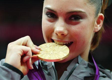 FILE PHOTO: McKayla Maroney of the U.S. poses with her gold medal during a ceremony after the women's gymnastics team final in the North Greenwich Arena at the London 2012 Olympic Games July 31, 2012. REUTERS/Brian Snyder