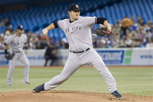 New York Yankees starting pitcher Phil Hughes works against Toronto Blue Jays during the first inning of a baseball game in Toronto on Sunday Sept. 30, 2012. (AP Photo/The Canadian Press, Chris Young)
