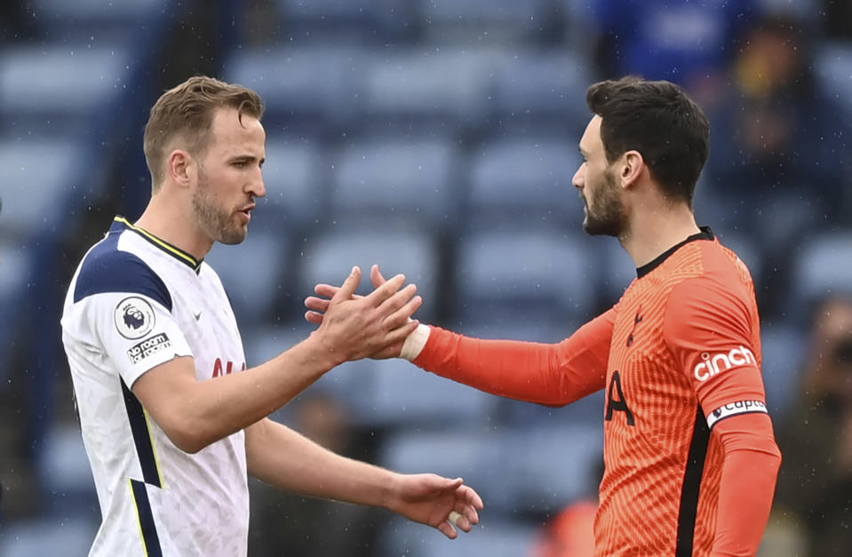 Tottenham's Harry Kane, left, shakes hands with Tottenham's goalkeeper Hugo Lloris at the end of the English Premier League soccer match between Leicester City and Tottenham Hotspur at the King Power Stadium, in Leicester, England, Sunday, May 23, 2021. (Shaun Botterill/Pool via AP)