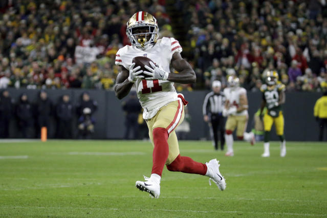 """<a class=""""link rapid-noclick-resp"""" href=""""/nfl/teams/san-francisco/"""" data-ylk=""""slk:San Francisco 49ers"""">San Francisco 49ers</a> wide receiver <a class=""""link rapid-noclick-resp"""" href=""""/nfl/players/26701/"""" data-ylk=""""slk:Marquise Goodwin"""">Marquise Goodwin</a> is officially the fastest player in the NFL after winning the """"40 Yards of Gold"""" sprinting competition on Saturday night. (AP/Mike Roemer)"""