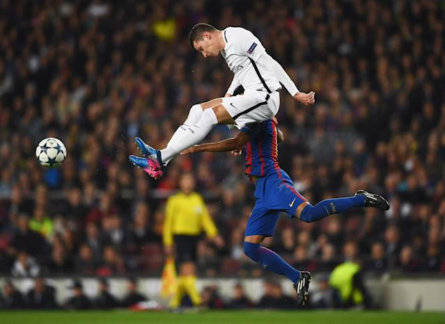 <p>Julian Draxler of PSG jumps with Rafinha of Barcelona during the UEFA Champions League Round of 16 second leg match between FC Barcelona and Paris Saint-Germain at Camp Nou on March 8, 2017 in Barcelona, Spain. (Photo by Laurence Griffiths/Getty Images) </p>