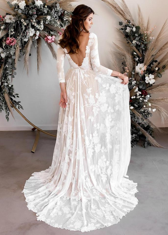 "<p>This <a href=""https://www.popsugar.com/buy/WearYourLoveXO-Long-Sleeve-Wedding-Dress-582330?p_name=WearYourLoveXO%20Long-Sleeve%20Wedding%20Dress&retailer=etsy.com&pid=582330&price=918&evar1=fab%3Aus&evar9=47551973&evar98=https%3A%2F%2Fwww.popsugar.com%2Fphoto-gallery%2F47551973%2Fimage%2F47552383%2FWearYourLoveXO-Long-Sleeve-Wedding-Dress&list1=shopping%2Cwedding%2Cbride%2Cwedding%20dresses%2Cfashion%20shopping%2Cbest%20of%202020&prop13=api&pdata=1"" rel=""nofollow"" data-shoppable-link=""1"" target=""_blank"" class=""ga-track"" data-ga-category=""Related"" data-ga-label=""https://www.etsy.com/listing/714868258/long-sleeve-wedding-dress-open-back?ga_order=most_relevant&amp;ga_search_type=all&amp;ga_view_type=gallery&amp;ga_search_query=wedding+dress&amp;ref=sr_gallery-1-5&amp;organic_search_click=1&amp;frs=1"" data-ga-action=""In-Line Links"">WearYourLoveXO Long-Sleeve Wedding Dress</a> ($918) has a perfect five-star rating on Etsy.</p>"
