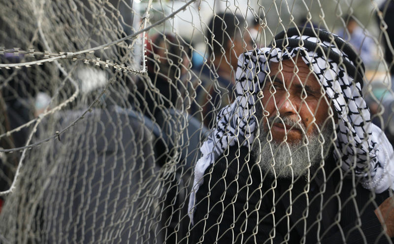 A Palestinian man waits before crossing into Egypt through the Rafah border crossing, southern Gaza Strip, Thursday, May 26, 2011. Egypt's decision to end its blockade of Gaza by opening the only crossing to the Hamas-ruled Palestinian territory this weekend could ease the isolation of 1.4 million Palestinians there. (AP Photo/Eyad Baba)