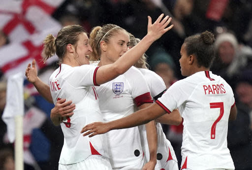 England's Ellen White, left, celebrates scoring her side's first goal with teammates, during the Women's International Friendly soccer match between England and Germany, at Wembley Stadium, in London, Saturday, Nov. 9, 2019. (John Walton/PA via AP)