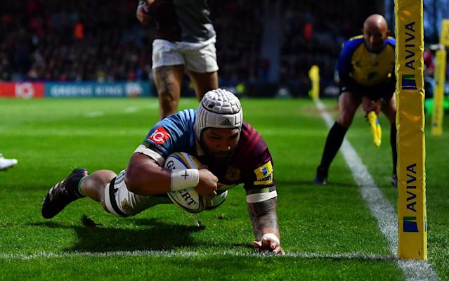 <span>Mat Luamanu of Harlequins dives over to score his side's first try</span> <span>Credit: Getty Images </span>