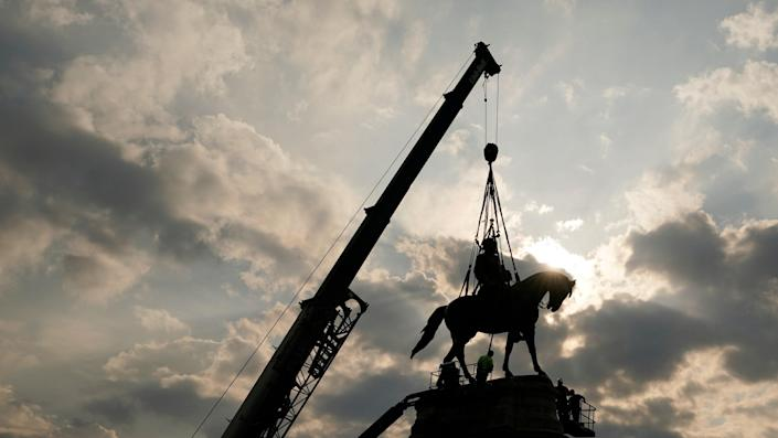 Crews work to remove one of the country's largest remaining monuments to the Confederacy, a towering statue of Confederate Gen. Robert E Lee on Monument Avenue, in Richmond, Virginia. (Copyright 2021 The Associated Press. All rights reserved)