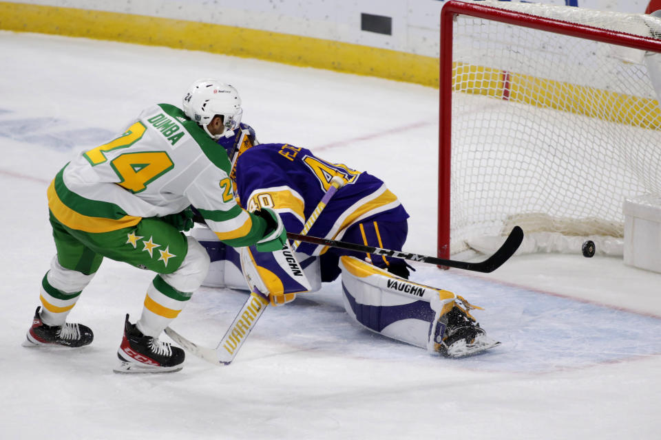 Minnesota Wild defenseman Matt Dumba (24) scores the winning goal against Los Angeles Kings goaltender Calvin Petersen (40) in overtime of an NHL hockey game, Saturday, Feb. 27, 2021, in St. Paul, Minn. (AP Photo/Andy Clayton-King)