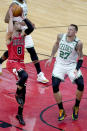 Chicago Bulls' Zach LaVine shoots over Boston Celtics' Daniel Theis during the second half of an NBA basketball game Monday, Jan. 25, 2021, in Chicago. (AP Photo/Charles Rex Arbogast)
