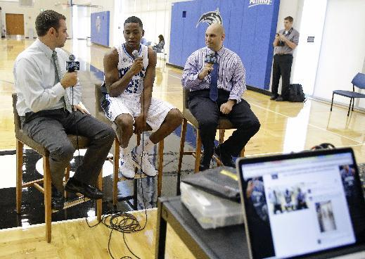 Orlando Magic's Maurice Harkless, center, answers questions during an interview at NBA basketball media day, Monday, Sept. 30, 2013, in Orlando, Fla. (AP Photo/John Raoux)