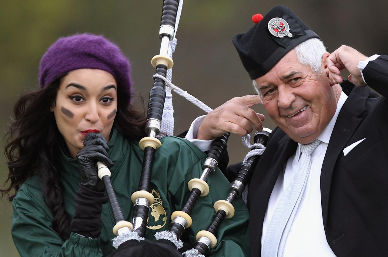 CRIEFF, SCOTLAND - OCTOBER 24:  Kanishtha Dhankhar from India poses with pipe Major David Boyle during the Miss World Highland Games at Crieff Hotel on October 24, 2011 in Crieff, Scotland. One hundred and twenty two participants of the Miss World are visiting Scotland to as part of a UK tour to celebrate Miss World's 60th birthday. The final of the competition will take place in Earls Court, London on Sunday 6trh of November.  (Photo by Jeff J Mitchell/Getty Images)