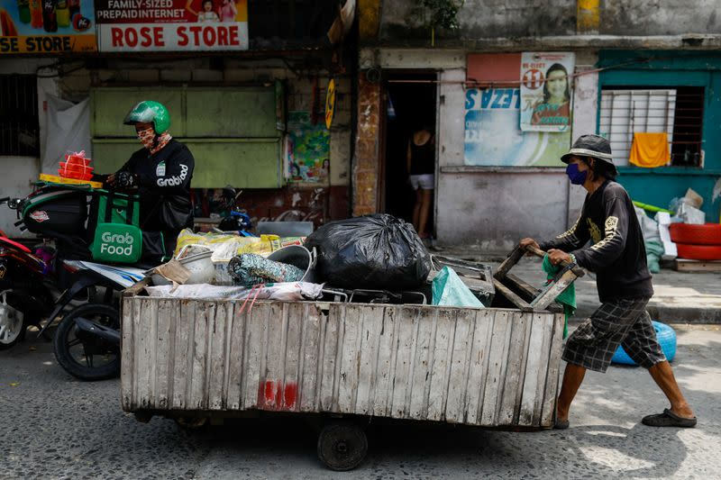 Philippine trash trawlers earn little from virus-boosted surge in plastics