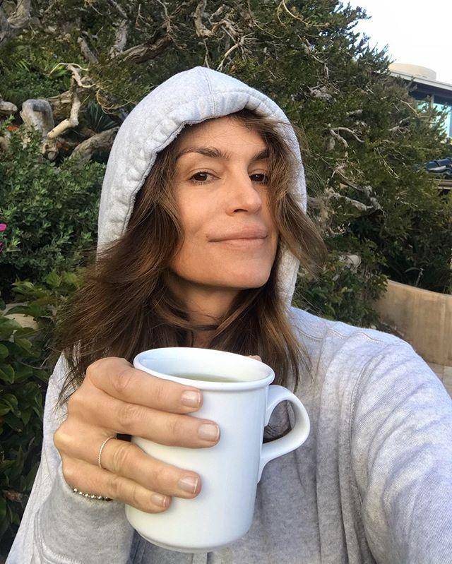 "<p>Caffeine, anyone? Cindy greets her followers makeup-free one morning in Malibu. </p><p><a href=""https://www.instagram.com/p/Bxp4QvHFlUD/?utm_source=ig_embed&utm_campaign=loading"" rel=""nofollow noopener"" target=""_blank"" data-ylk=""slk:See the original post on Instagram"" class=""link rapid-noclick-resp"">See the original post on Instagram</a></p>"