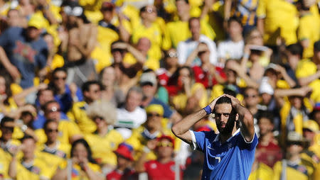 Greece's Giorgios Samaras react after Colombia's Teofilo Gutierrez scored a goal during their 2014 World Cup Group C soccer match at the Mineirao stadium in Belo Horizonte June 14, 2014. REUTERS/Sergio Perez