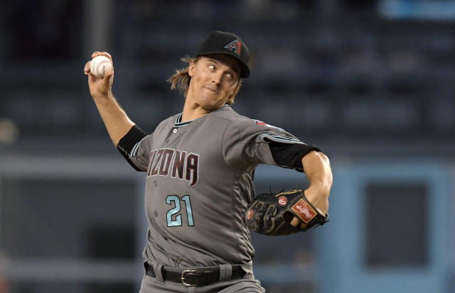 Arizona Diamondbacks starting pitcher Zack Greinke throws to the plate during the first inning of a baseball game against the Los Angeles Dodgers, Friday, Aug. 31, 2018, in Los Angeles. (AP Photo/Mark J. Terrill)