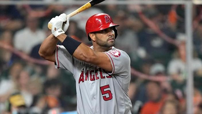 Los Angeles Angels' Albert Pujols bats against the Houston Astros during the eighth inning of a baseball game Friday, April 23, 2021, in Houston. (AP Photo/David J. Phillip)