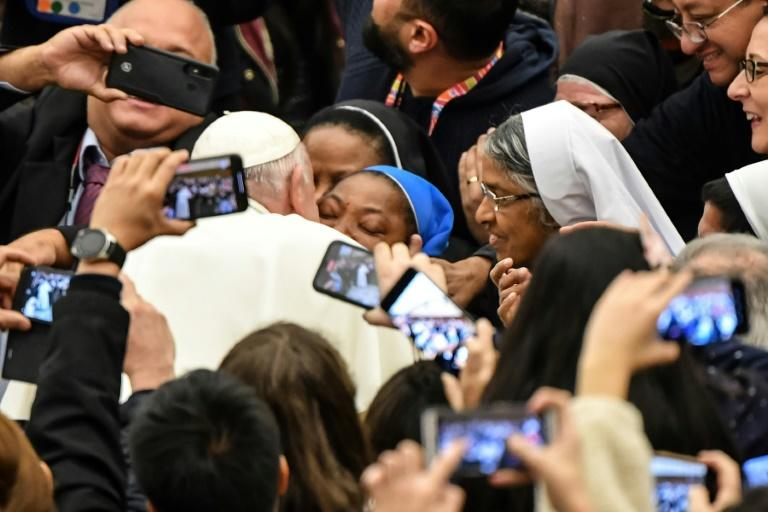 Pope Francis kisses a nun who had been shouting 'Long live the pope!'