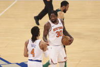 New York Knicks forward Julius Randle (30) celebrates with guard Derrick Rose (4) after an NBA basketball game against the Boston Celtics in New York, Sunday, May 16, 2021. (Vincent Carchietta/Pool Photo via AP)