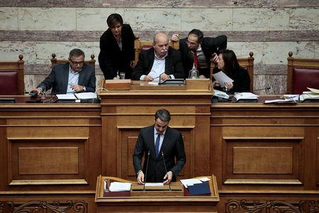 Greek conservative New Democracy party leader Kyriakos Mitsotakis addresses lawmakers as Parliament Speaker Nikos Voutsis chairs a parliamentary session before a vote on setting up a special committee which will probe the role of ten politicians in a case which involves alleged bribery by Swiss drugmaker Novartis, in Athens, Greece, February 21, 2018. REUTERS/Alkis Konstantinidis     TPX IMAGES OF THE DAY
