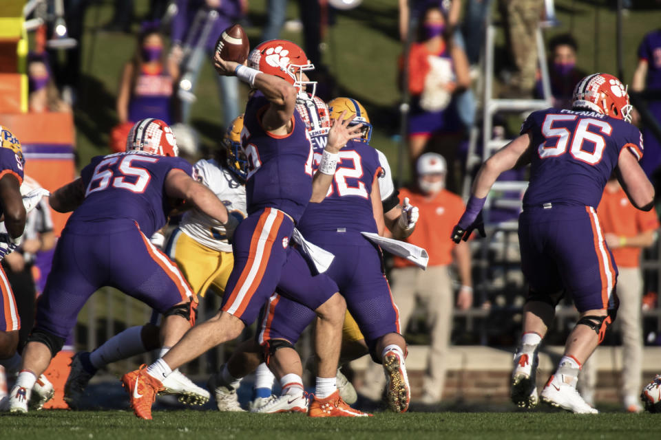 Clemson quarterback Trevor Lawrence (16) makes a pass during the first half of an NCAA college football game against Pittsburgh Saturday, Nov. 28, 2020, in Clemson, S.C. (Ken Ruinard/Pool Photo via AP)