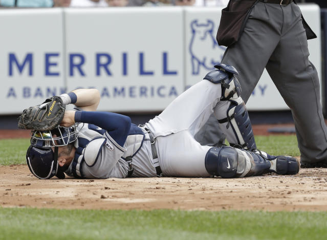 Tampa Bay Rays catcher Travis d'Arnaud lies on the ground after being hit by the ball during the first inning of a baseball game against the Tampa Bay Rays at Yankee Stadium, Wednesday, June 19, 2019, in New York. (AP Photo/Seth Wenig)