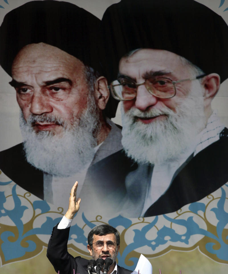 Iranian President Mahmoud Ahmadinejad, speaks under portraits of the late Ayatollah Khomeini, left, and Iranian Supreme Leader Ayatollah Ali Khamenei during an annual rally commemorating the anniversary of the 1979 Islamic revolution, which toppled the late pro-U.S. Shah, Mohammad Reza Pahlavi, in Azadi  Square, Tehran, Iran, Sunday, Feb. 10, 2013. In his statements to the rally, Ahmadinejad said he is ready to have direct talks with United States if the West stops pressuring his country. (AP Photo/Vahid Salemi)