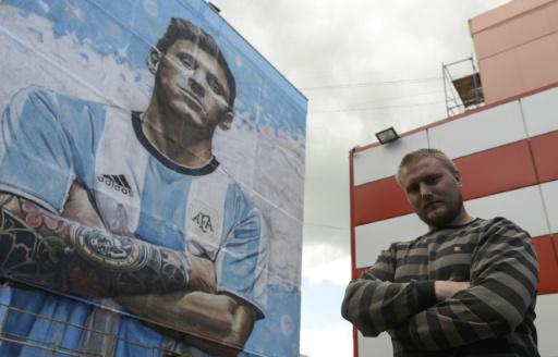 A larger-than-life version of Lionel Messi greets passers-by in Bronnitsy