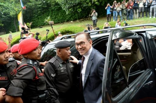 Anwar arrives at his house following his release