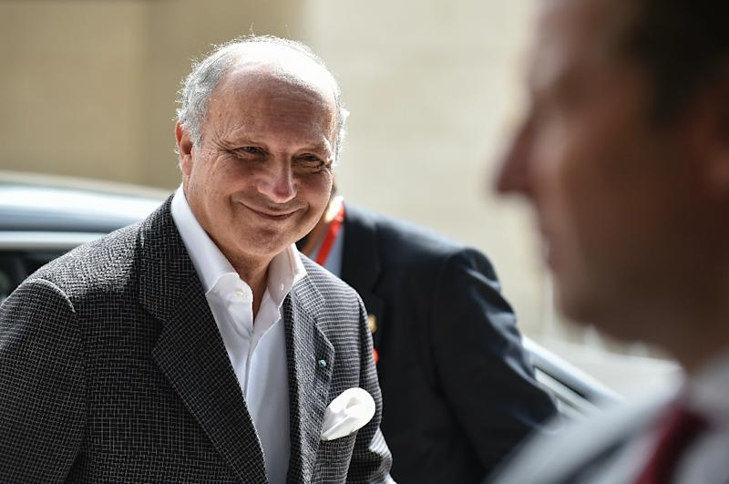 """French Foreign Minister Laurent Fabius, seen in Luxembourg on September 4, 2015, told reporters that his presence at the ceremony to raise the Palestinian flag at the UN would highlight France's """"continued support for a two-state solution"""""""