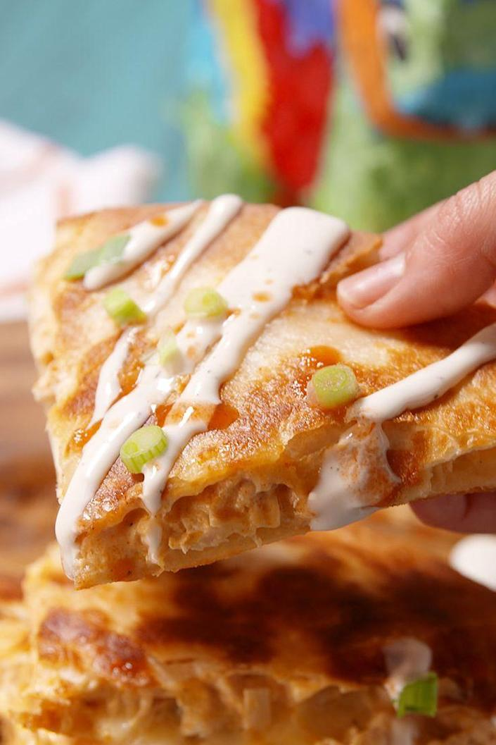 """<p>This is our new favorite way to eat buffalo.</p><p>Get the recipe from <a href=""""https://www.delish.com/cooking/recipe-ideas/recipes/a50289/buffalo-chicken-quesadilla-recipe/"""" rel=""""nofollow noopener"""" target=""""_blank"""" data-ylk=""""slk:Delish"""" class=""""link rapid-noclick-resp"""">Delish</a>.</p>"""