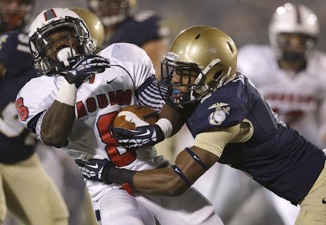 South Alabama running back Jay Jones, left, is tackled by Navy cornerback Parrish Gaines in the second half of an NCAA college football game in Annapolis, Md., Saturday, Nov. 16, 2013. (AP Photo/Patrick Semansky)